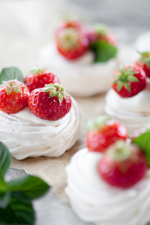 Mini pavlova with strawberries and mint