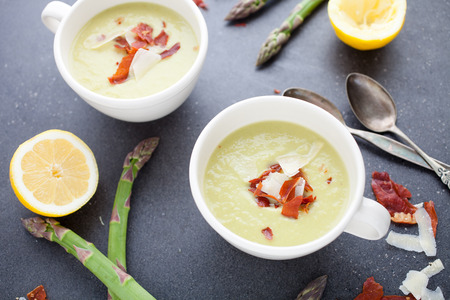 Asparagus soup wit roasted prociutto Stock Photo