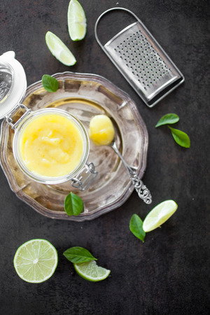 Homemade lime curd with slices and leaves Stock Photo