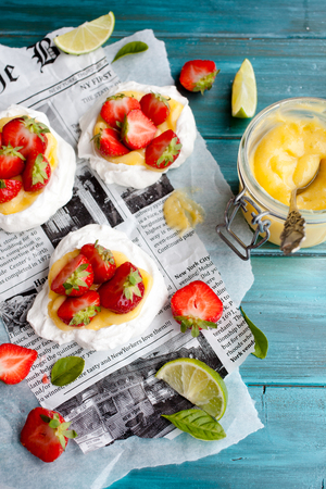 Mini pavlovas with strawberries and lime