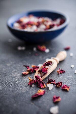 Bath salt with pink dried rose petals