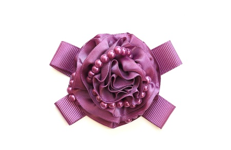 A purple decorative ribbon in form of flower Stock Photo