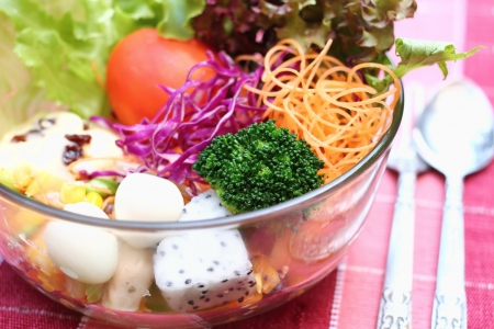 Close up salad in glass bowl with egg, vegetable and fruit
