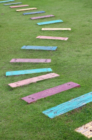 Colorful wooden pathway steps lead to the backyard Stock Photo