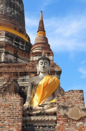 Ancient buddha statue with blue sky, Ayutthaya, Thailand