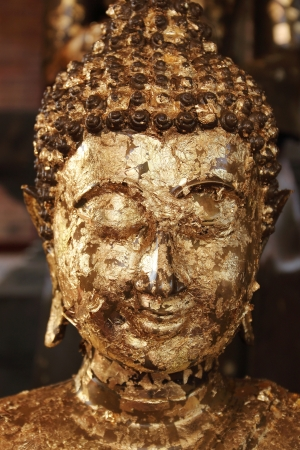 Close up buddha image covered with gold leaves at Wat Yai Chai Mongkhol, Ayutthaya, Thailand