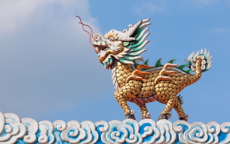 Dragon horse statue with cloud and blue sky in chinese temple, Thailand