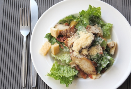Chicken ceasar salad on wooden table