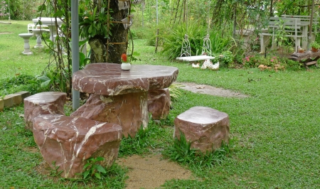 Garden table and four chairs, made from stone photo
