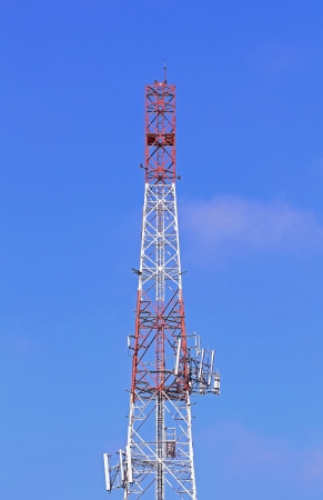 Communication tower over a blue sky  photo