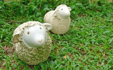 Two sheep statues decorate in a garden Stock Photo