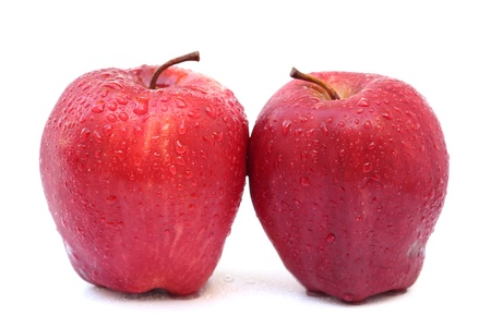 Close up two red apples isolated on white background
