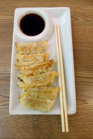 gyoza: Gyoza on a white plate  Stock Photo