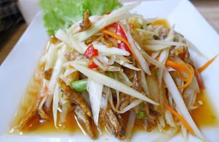 Thai papaya salad  Som Tum  on white plate photo