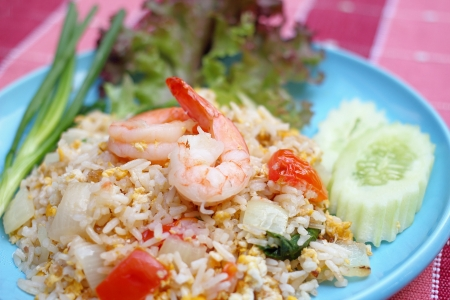 Close up shrimp fried rice on a blue plate Stock Photo