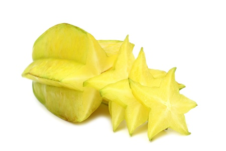 Carambola with slice isolated on white background  with selective focus