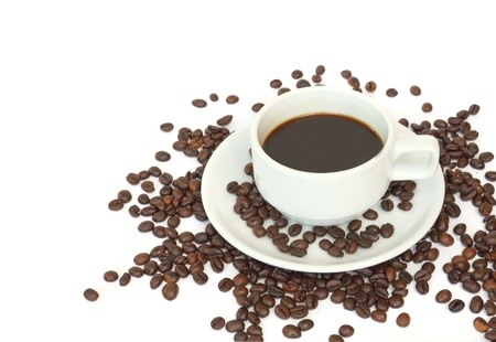 Cup of coffee with some coffee beans on white background