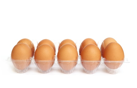 Eggs in the plastic package isolated on white background