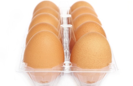 Close up eggs in the package isolated on white background