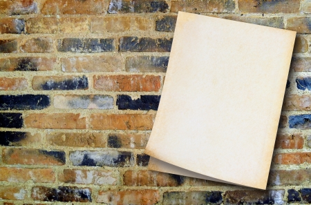 Old paper on vintage wall background  with space for text