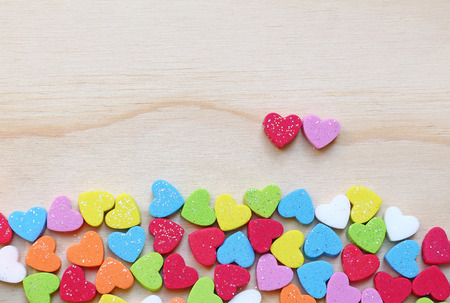 Colorful heart shape on wooden background