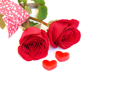 Red rose with red heart on white background, love concept Stock Photo