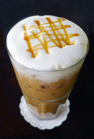 Ice coffee with milk and caramel