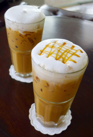 Ice coffee with milk and caramel, put on the table