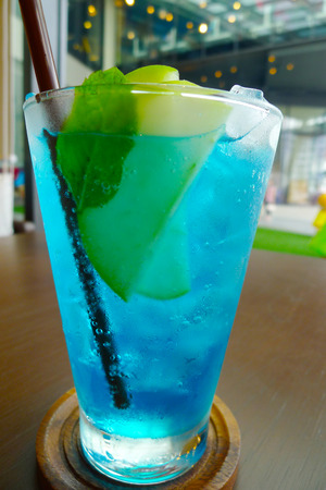 Apple with blue soda soft drink