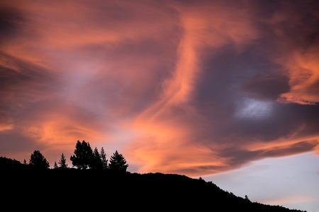ridgeline: Mountain ridge silhouetted against fiery sky