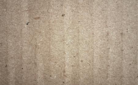 millboard:  texture of coarse gray cardboard close up