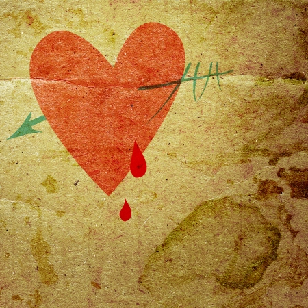 waivers: heart with an arrow, and drops of blood on the background grunge board Stock Photo