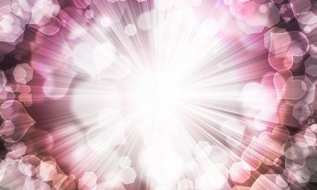 heartache: abstract background of blurred lights in the shape of the heart and shining rays Stock Photo