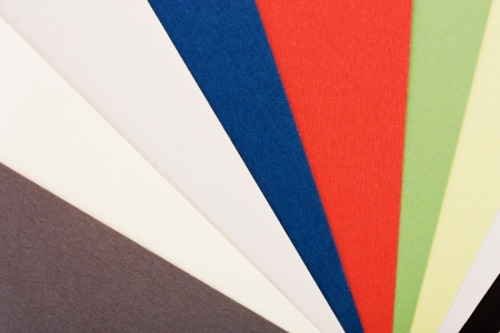 Colorful paper for business cards fan close-up photo