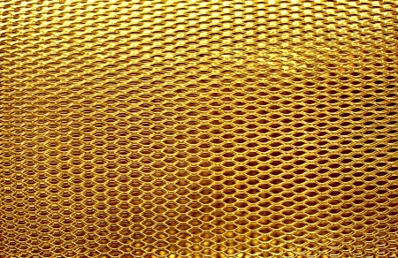 conclude: metal mesh grate gold background
