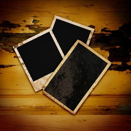 Blank photo frame on the grunge wood background Stock Photo - 16328183