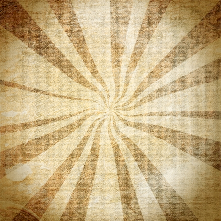 Abstract rays on a vintage fabric with various stains photo