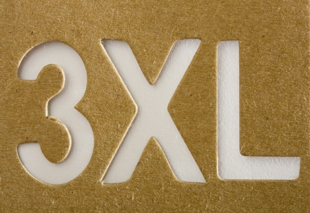 xxxl: XXXL stencil on cardboard texture, background