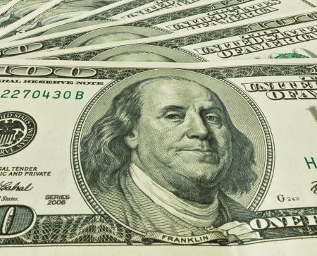 facilitating:   background of one hundred dollars, closeup Stock Photo