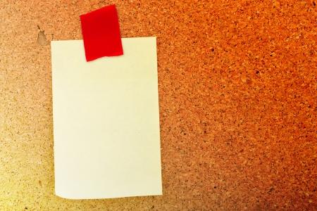 blank sticker glued blue ribbon to a cork board Stock Photo - 16340980