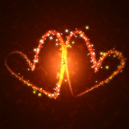 burning hearts with sparkles on a dark background  photo