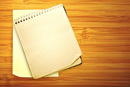 old used notebook on a wooden background Stock Photo - 16340844