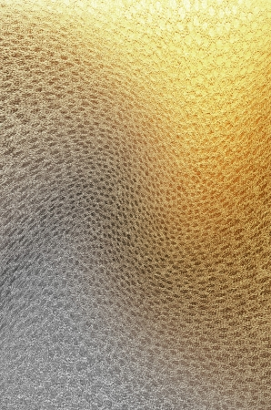 resplendence: texture silver gold leather with uneven illumination Stock Photo