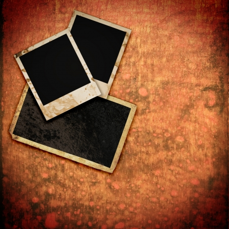Blank photo frame on the grunge wood background  photo