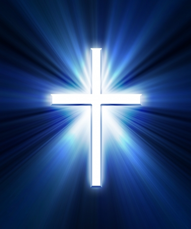 religious symbols:     glowing cross on a black background, with radial rays of light Stock Photo