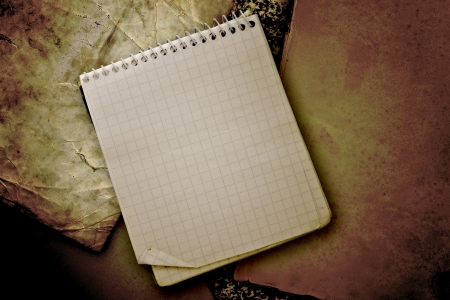 infamous: old used notebook on  vintage background