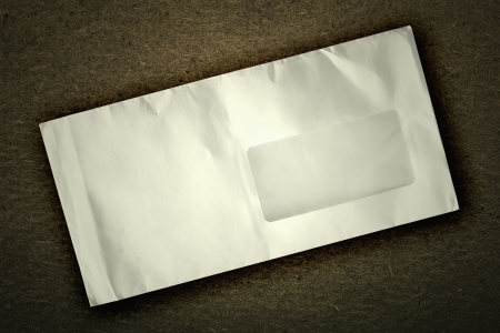 white old  envelope  on a vintage background Stock Photo - 16340692