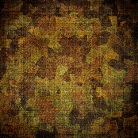 backgrounds grungy dots: dingy camouflage on natural canvas  Stock Photo