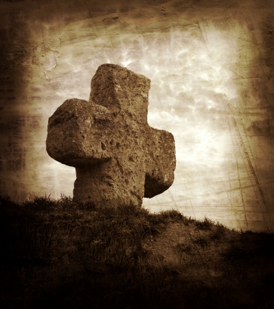 old stone cross on the background of a beautiful sunset Stock Photo - 16395515