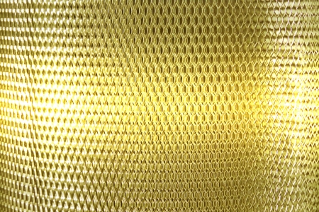 metal mesh grate gold, yellow background Stock Photo - 16396480
